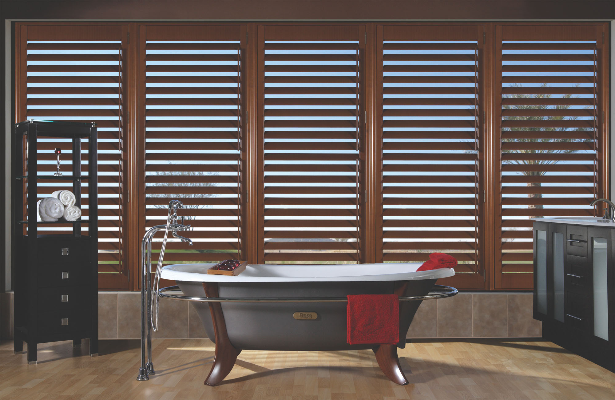 Custom-fitted wood and faux wood shutters for wet and dry areas