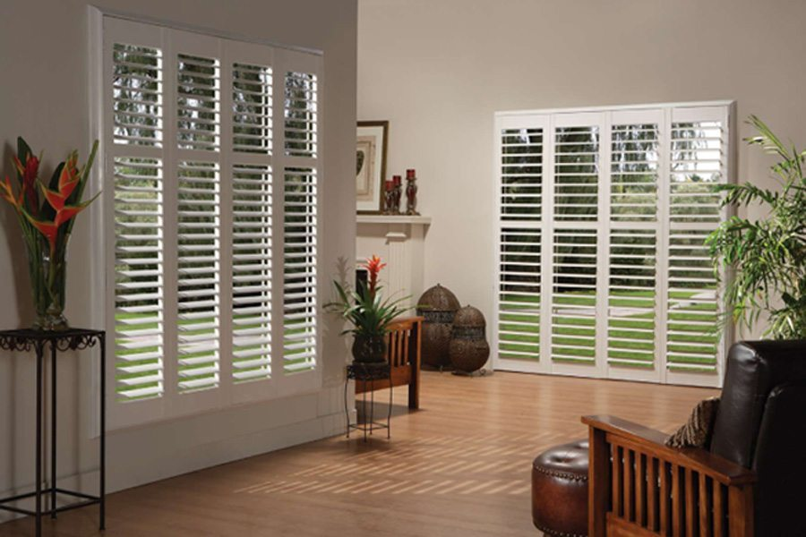 Laser-measured wood and faux-wood shutters blend perfectly with the design of your home